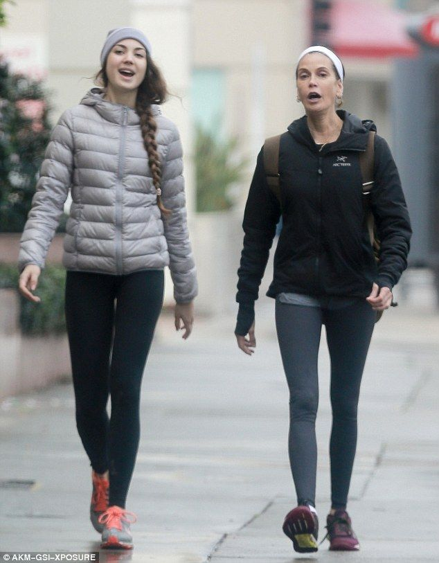 Off for a spin: Teri Hatcher braved the rain for a workout session with her dress-a-like daughter Emerson in Studio City on Tuesday