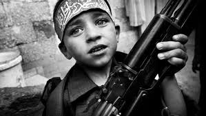 documentary photography - Child Soldier carrying a fire arm.
