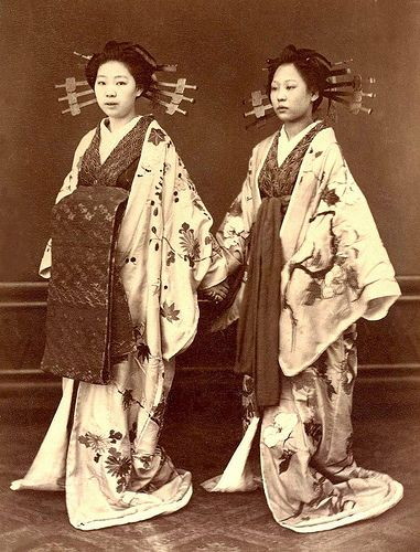 Yoshiwara girls (prostitutes ) - Two Ties by Okinawa Soba, via Flickr.  This is an important 1870s photograph by a Japanese photographer showing two prostitutes. Although it is generally understood that Japanese Prostitutes always tied their OBI in the FRONT --- where it could be quickly undone for business reasons --- clear photos of the various styles of this tie are hard to find.