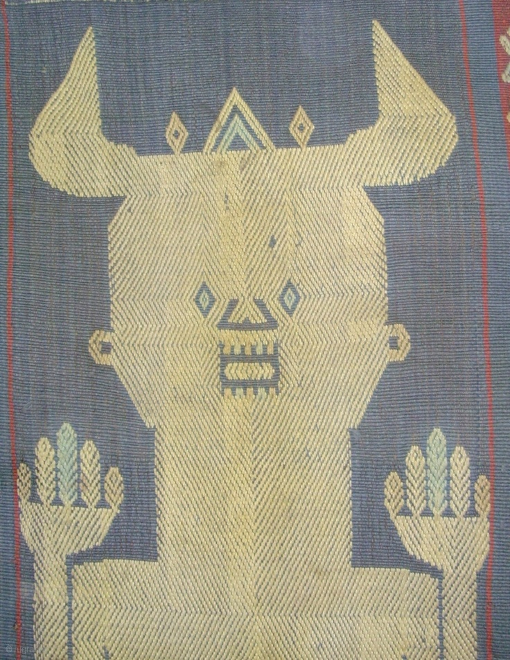 Sumba Hinggi . Mystical figure bold human figure with mysterious designs on his chest. Very well executed. The work of a master weaver.
