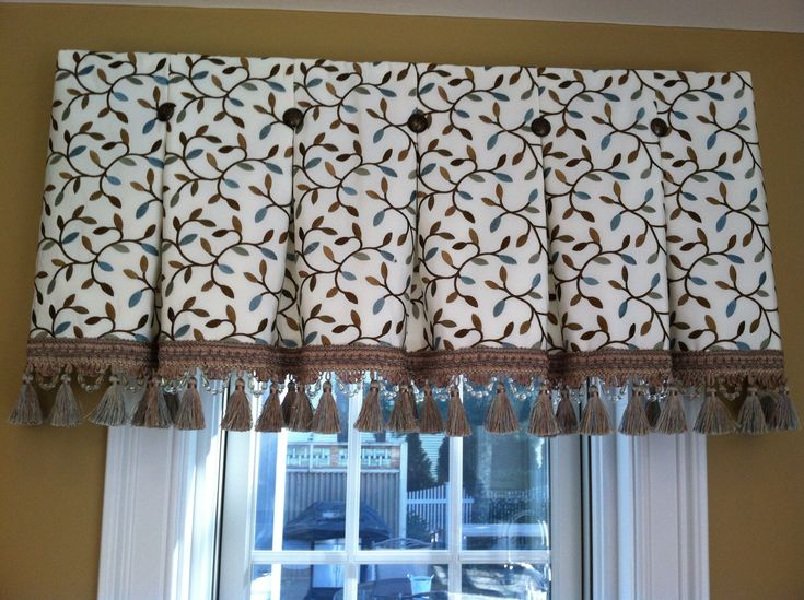 Inverted box pleat valance tacked with bronze nail heads at each pleat. Robert Allen fabric and Lady Anne trim