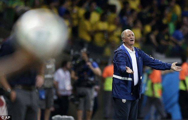 Despair: Brazil coach Luiz Felipe Scolari looks helpless as he watches his side crumble ag...