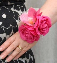 Artificial Cerise Rose and Silk Orchid Wrist Corsage.  With foam cerise roses,silk pink orchids and loops of pearls.