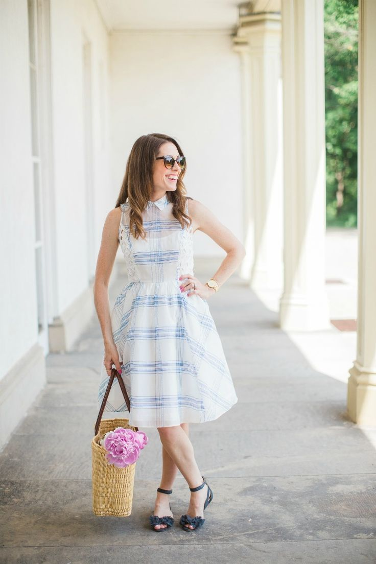 Looking for the perfect summer outfit? Art in the Find shares a blue and white eyelet dress that's a perfect fit for a garden party.