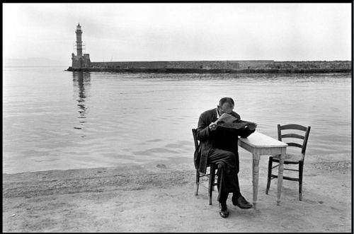 Constantine Manos - A Greek Portfolio / A man reads a newspaper in Chania, Greece 1967.