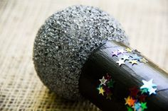 Channel your inner pop star with our super easy, sparkly DIY microphone craft!