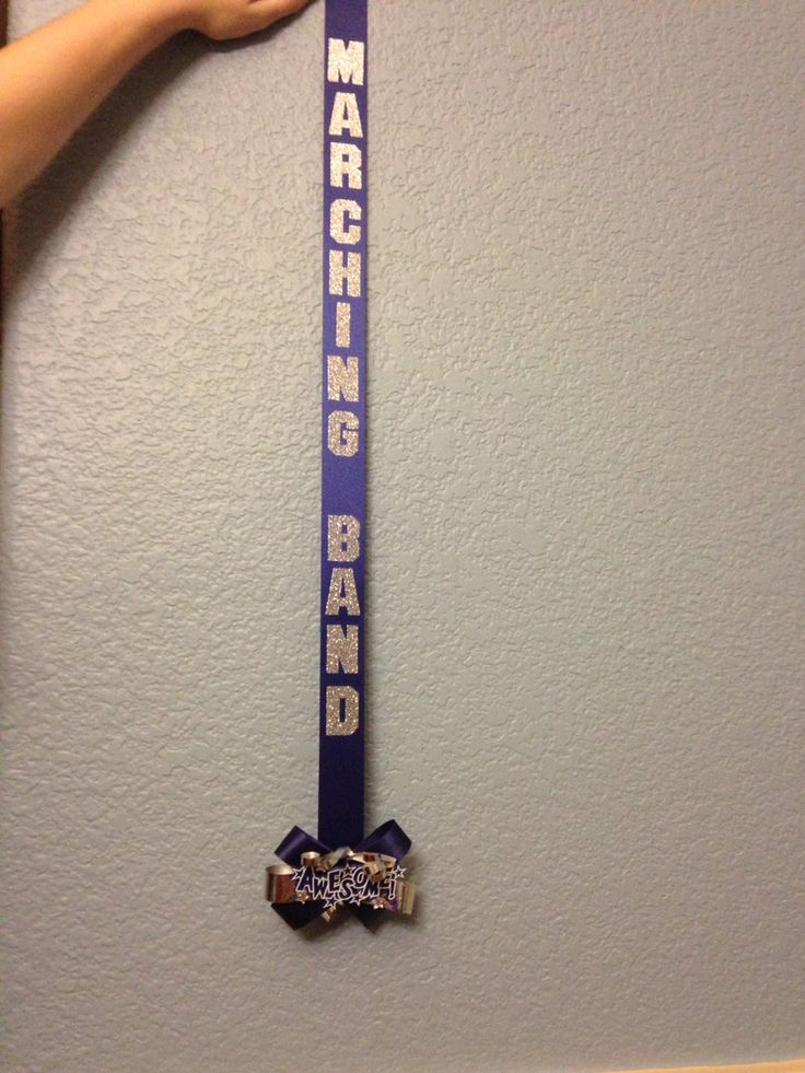 Marching band ribbon with bow with trinket on the bottom