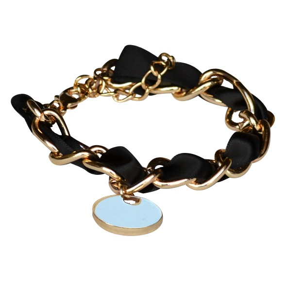 Vintage charm in black     Gold color faux chain bracelet , with black satin ribbon. There is a round charm hanging.