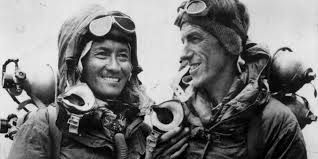 Sir Edmund Hilary and Tenzing Norgay reach the summit of Mount Everest