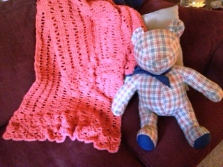 Coral Prayer Shawl & a bear my mother made shortly before her death in 1998.