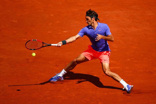 Roger Federer Photos Photos - Roger Federer of Switzerland plays a forehand during his Men's Singles match against Alejandro Falla of Colombia on day one of the 2015 French Open at Roland Garros on May 24, 2015 in Paris, France. - 2015 French Open - Day One