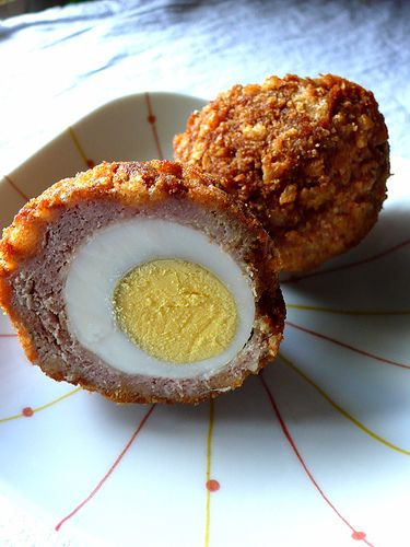 Scotch Eggs - a hardboiled egg encased in sausage meat, rolled in breadcrumbs and then fried.
