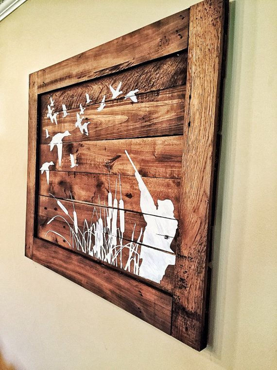 Duck hunting handpainted wood sign on reclaimed wood stained and painted to match your home decor! A hunters home decor at its finest for any room of the house! This piece is 24in tall and 30in wide. This can be made in different sizes and colors or stains. Please message me with any changes. If ordered it will be 24x30 and white paint with a kona dark stain. All shipping is subject to location and size and can range in price.  IF NO SPECIFIC NOTE WHEN ORDERING THIS WILL BE PAINTED WITHOUT…