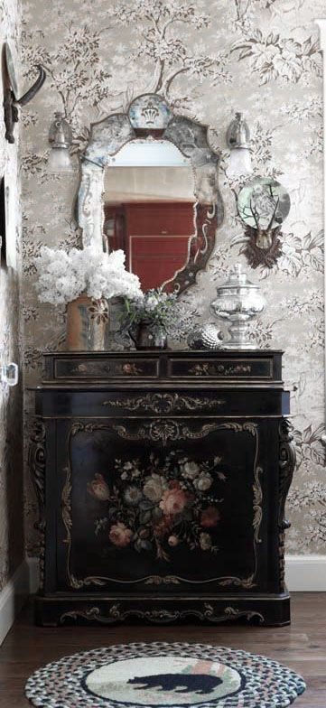 Dove gray, white, and black wallpaper pairs nicely with this black floral console table. I LOVE that table