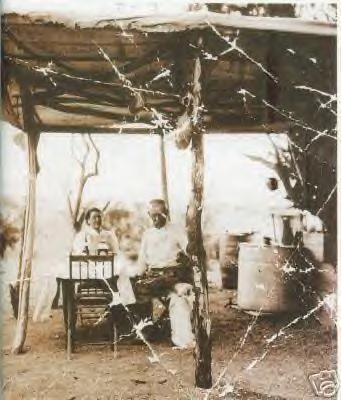 Josephine and Wyatt Earp at their campsite, 1920s