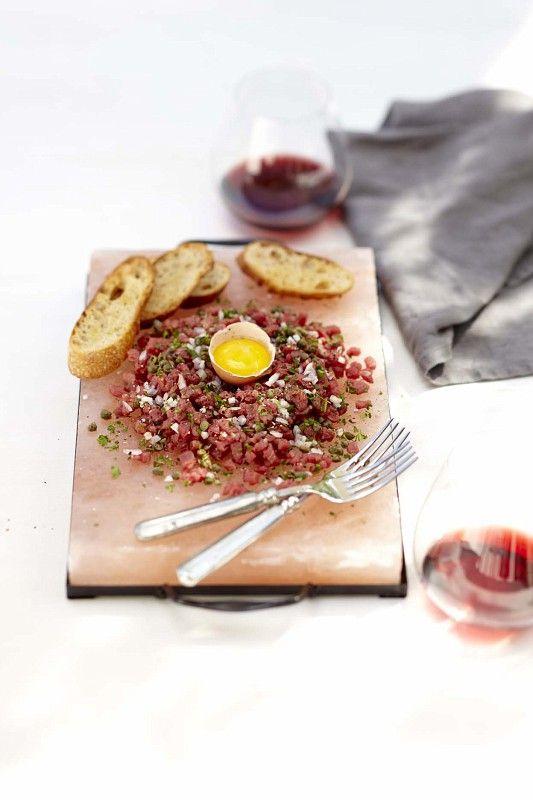 Beef Tartare with Crostini, served on a pink salt slab