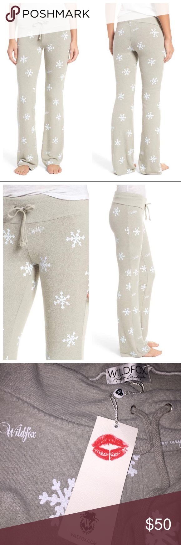 "Wildfox Winter Wonderland Lounge Pants Let it snow, let it snow, let it snow—both outside and all over these ultra-snuggly lounge pants. The soft stretch-knit fabric and wide drawstring waistband will keep you perfectly comfy through the worst winter storms. •32 1/2"" inseam; 19"" leg opening; 8 1/2"" front rise; 12"" back rise (size Medium) •Drawstring waist •47% rayon, 47% polyester, 6% spandex •Machine wash cold, tumble dry low •Made in the USA •Color is slightly darker than stock photos…"
