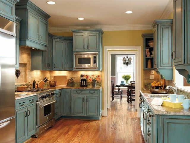 Turquoise/Rust cabinets.