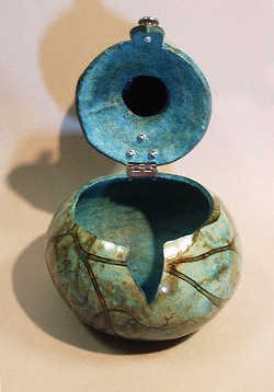 Gourd box opened showing how lid is hinged