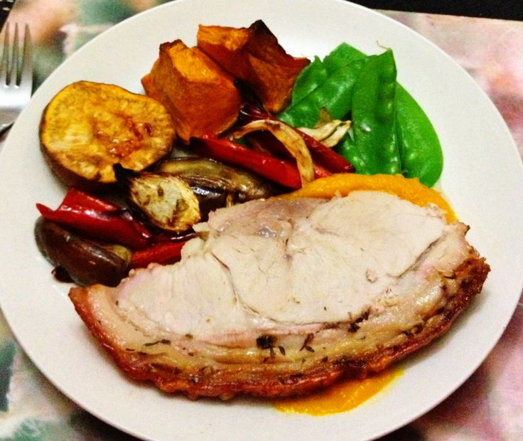 Roast rolled pork on a pumpkin purée with roasted veggies
