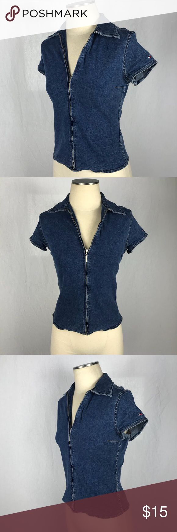 """TOMMY Hilfiger Stretch Denim Zip Up Blouse Cute Tommy Hilfiger zippered denim shirt.  Stretches  Short sleeved Collared Logo on shoulder Excellent condition. Size 2 Chest: 16"""" Top to bottom: 21"""" Lots of stretch! Tommy Hilfiger Tops Blouses"""