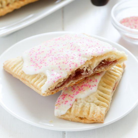 Homemade strawberry pop-tarts with fresh strawberry jam and an all butter flaky pie crust.