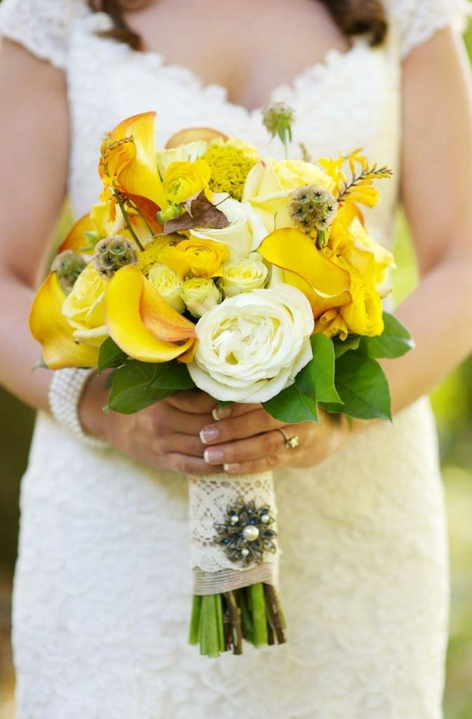 White Roses, Yellow Roses, Yellow Spray Roses, Yellow Calla Lilies, Yellow Ranunculus, Scabiosa Pods & Green Foliage Bridal Bouquet