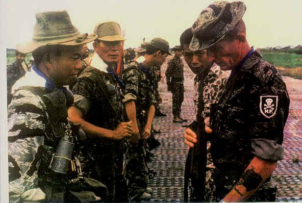 """MACV-SOG / Special Forces soldier, with handmade """"Mike Force"""" patch of skull and cross bones. ~ Vietnam War"""