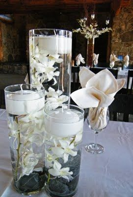 The submerged flower and floating candle is a very popular centerpiece the last few years. And you don't have to use Orchids.recently completed a wedding that used Snapdragons.