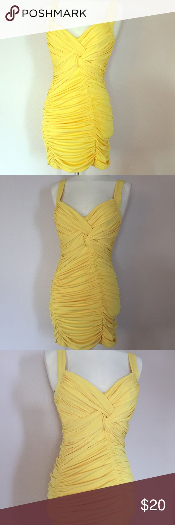 """Pinup Sexy Yellow Bodycon Mini Dress Retro Club S Super sexy pinup dress in sunshine yellow. Dress hugs every curve, and has a flattering fit. Worn and washed once, dress is in like new condition with tons of life left. Has a padded bust, and is made of poly spandex. Tagged a size small and measures 34"""" at bust, 28"""" at waist, 36"""" at hips, and length from underarm to hem is 26"""". Love Dresses Mini"""
