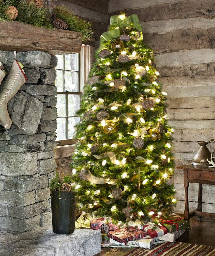 Inveterate collector Travis Robeson fills his Christmas cabin with simple and rustic decorations, like burlap ribbon and carved-wood cookie molds.