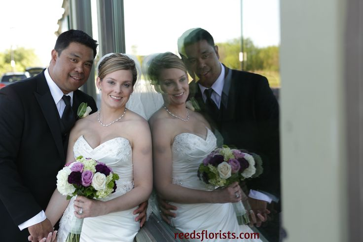 We love this picture of our bride and her new husband. Bouquet by www.reedsflorists.com