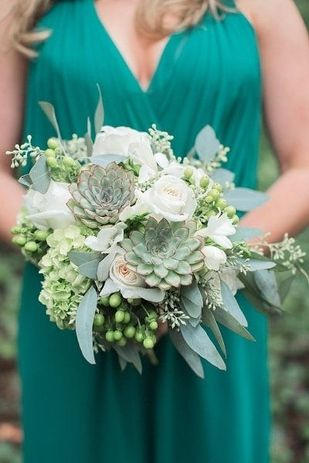 White roses, succulents, eucalyptus wedding bouquet
