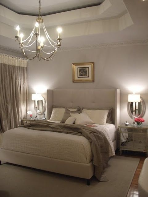 Beautiful master bedroom in neutrals with pretty chandelier and details. So romantic!