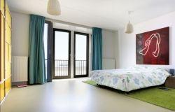 Gietvloer in slaapkamer - betonlook gietvloer prijzen