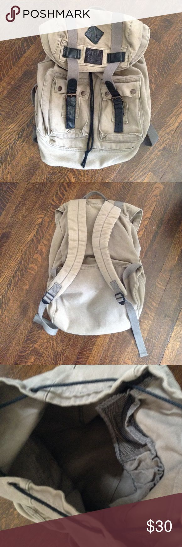 Excellent condition Converse drawstring backpack Used only a couple of times. Unique look with one large compartment and two small front pockets. Pen holders and mesh pouch inside. Converse Bags Backpacks