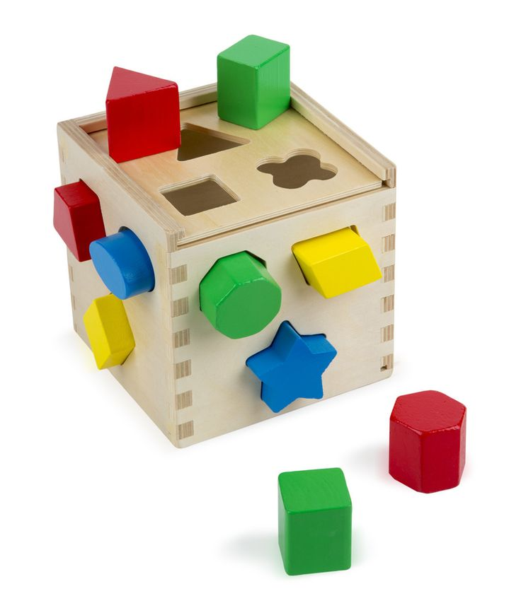 """This ultimate shape sorter features 12 chunky, vibrantly colored shapes that make a satisfying """"clunk"""" as they drop into the natural-finish hardwood cube. Then open the lid, take them out and start al"""