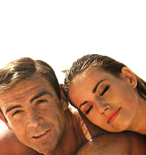 Sean Connery and Claudine Auger taking a break on the set of Thunderball, 1965