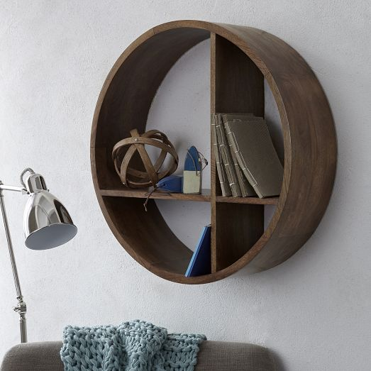 Made of solid mango wood in a warm honey finish, our Shape Wall Shelf features a versatile T-shaped divider that lets you hang it how you need it—a part storage piece, part display piece that's a creative twist on a classic wall shelf.