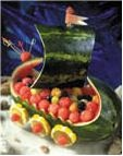 Chiff.com  Kids Pirate Party Food Ideas.  I like getting fruit on the table in a fun way, watermelon ship