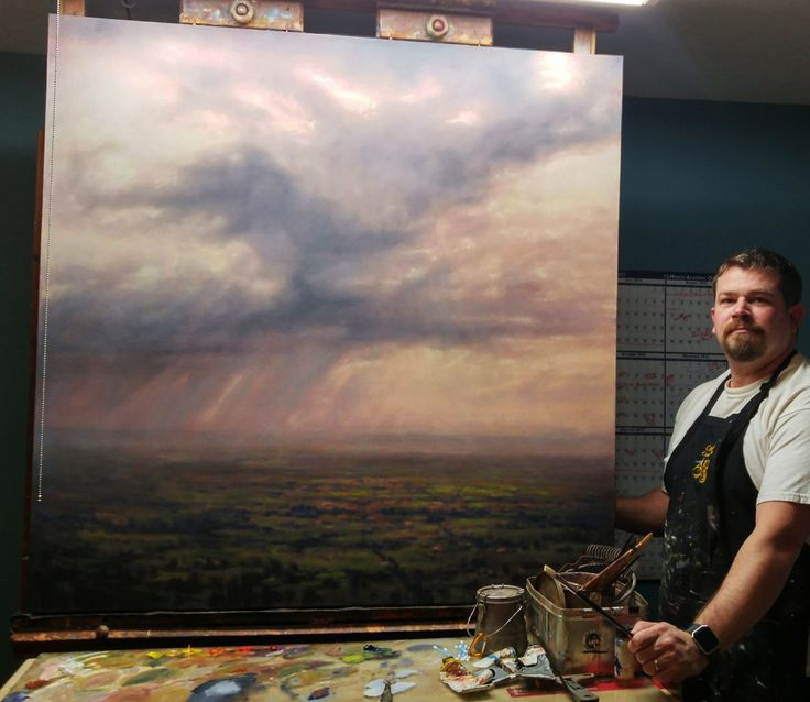 Michael Orwick stands with Tuscan Rain his new 48x48 oils on canvas, based on his trip around the world last year.