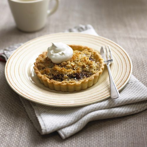 Treat yourself to these Banana and Nutella Crumble Tartlets from the cookbook Cupcakes and Mini Cakes. Whether enjoyed hot or cold, they are guaranteed to be a hit with adults and children alike.