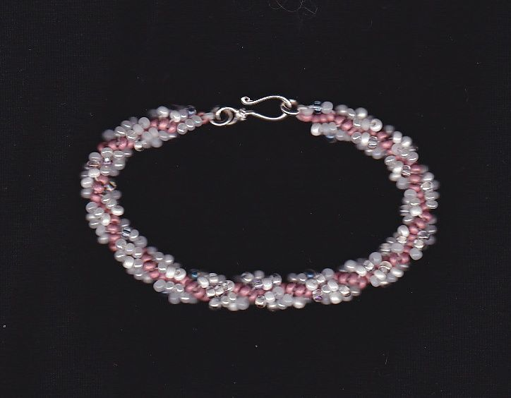 Pink spiral bracelet with sterling silver clasp.