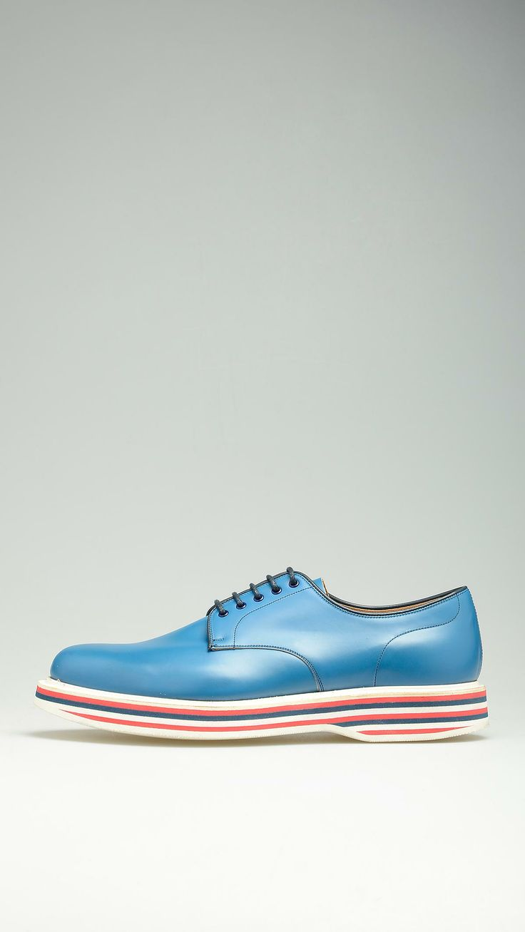 Cobalt leather lace-ups shoes featuring blu, red and white rubber platform sole, derby lace closure.