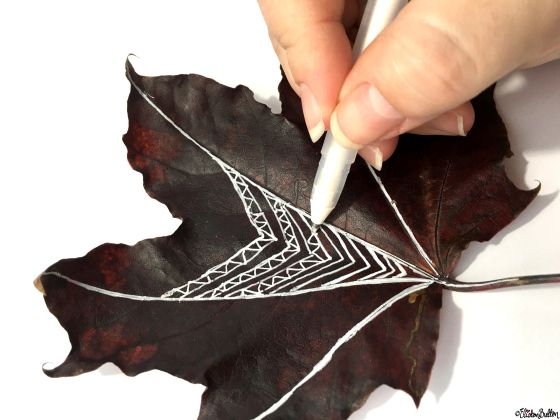 Drawing on Autumn Leaves with White Ink - Workspace Wednesday – Autumn Leaf Art at www.elistonbutton.com - Eliston Button - That Crafty Kid