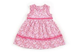 Vestido para bebe niña con estampado de florecitas fucsia, con cuello redondo y sin mangas.
