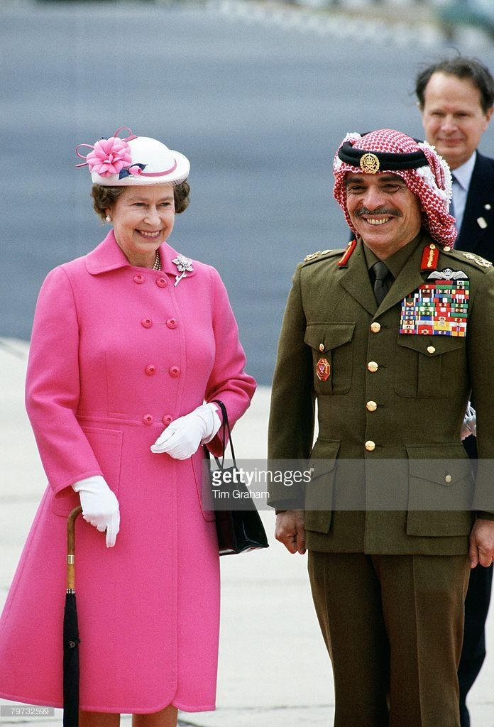 Queen Elizabeth II with King Hussein of Jordan on her arrival at Amman Military…