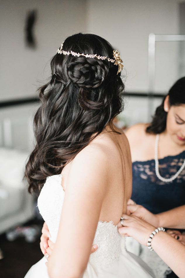 """We fell in love with the way our One Fine Day bride, Tu, wore her custom Paris by Debra Moreland """"Rue Plummet"""" halo and """"Fall Again"""" comb. Photographed by Della Terra Photography."""