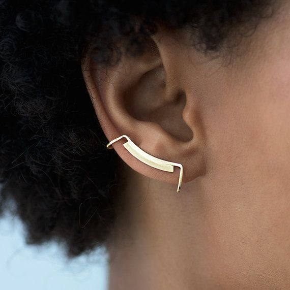 * Long, ear-hugging, minimalistic cuff with mirror-polished surface for high shine  * Curved pin-shaped post grips the ear comfortably  * For pierced