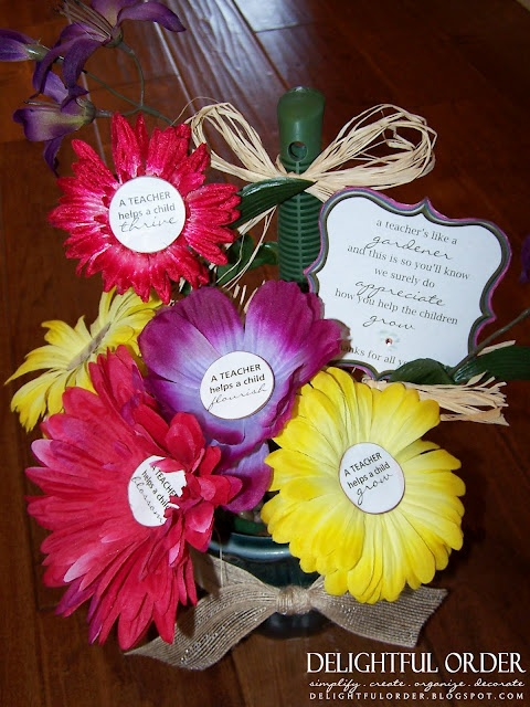 """Flower Pens -- all items can be bought at the Dollar Store!  Each flower pen says something different  """"A Teacher helps a child sprout * thrive * flourish * blossom * bloom * grow"""""""